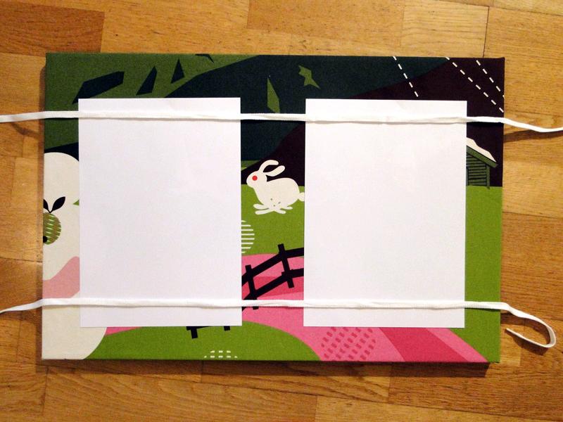 Pinnwand mit bändern als halterung für Zettel